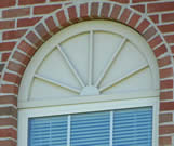 Half round window panel with sunburst
